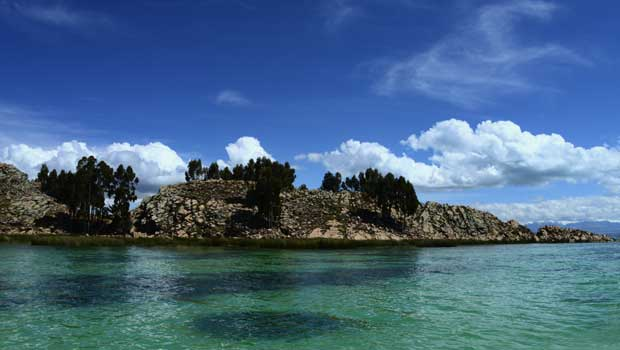 Lake Titicaca (Spanish: Lago Titicaca, pronounced [ˈlaɣo titiˈkaka]; Quechua: Titiqaqa Qucha) is a large, deep lake in the Andes on the border of Bolivia and Peru, often called the 'highest navigable lake' in the world.
